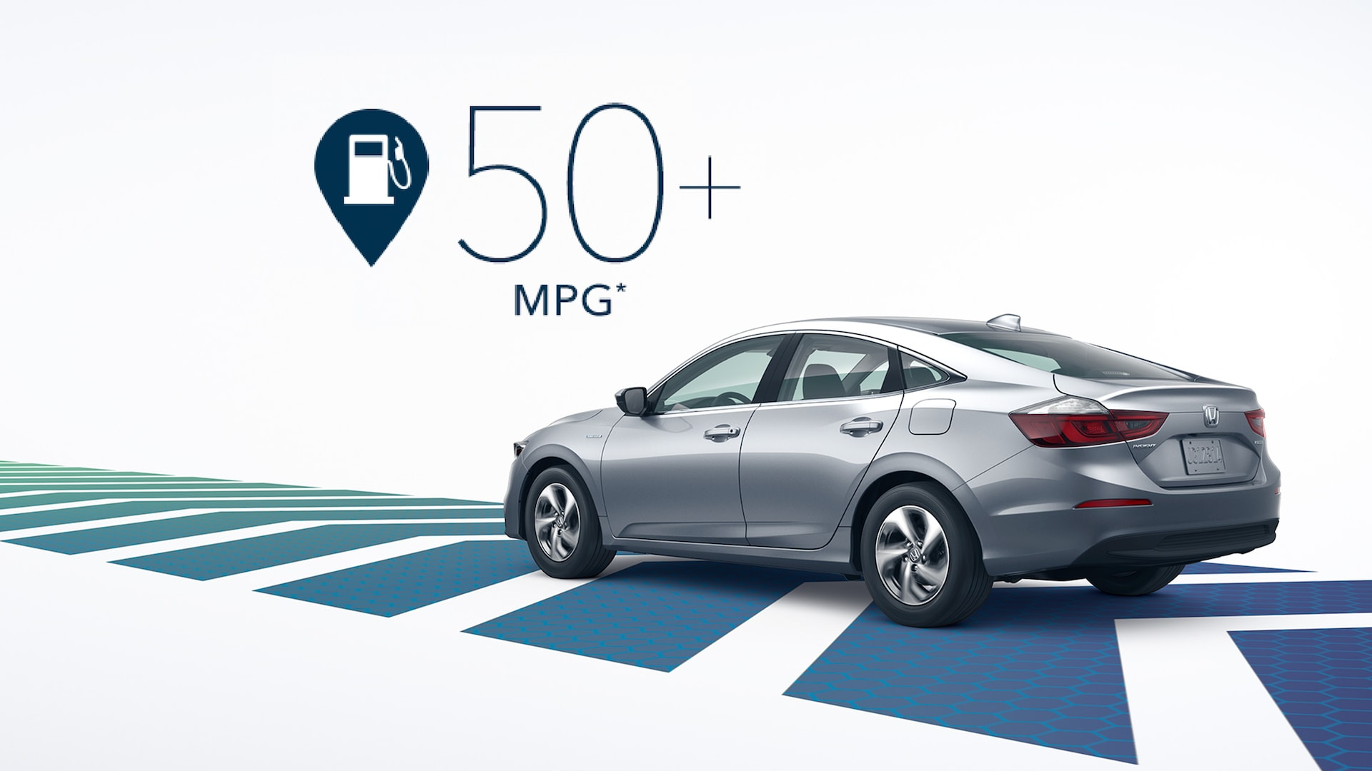Rear 7/8 driver's side view of 2020 Honda Insight Touring in Lunar Silver Metallic with MPG/Range graphic overlay.