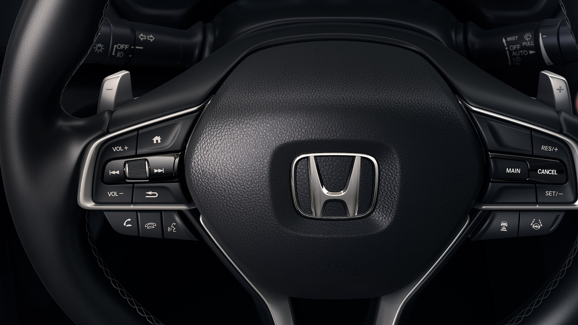 Steering wheel detail on 2020 Honda Insight Touring.