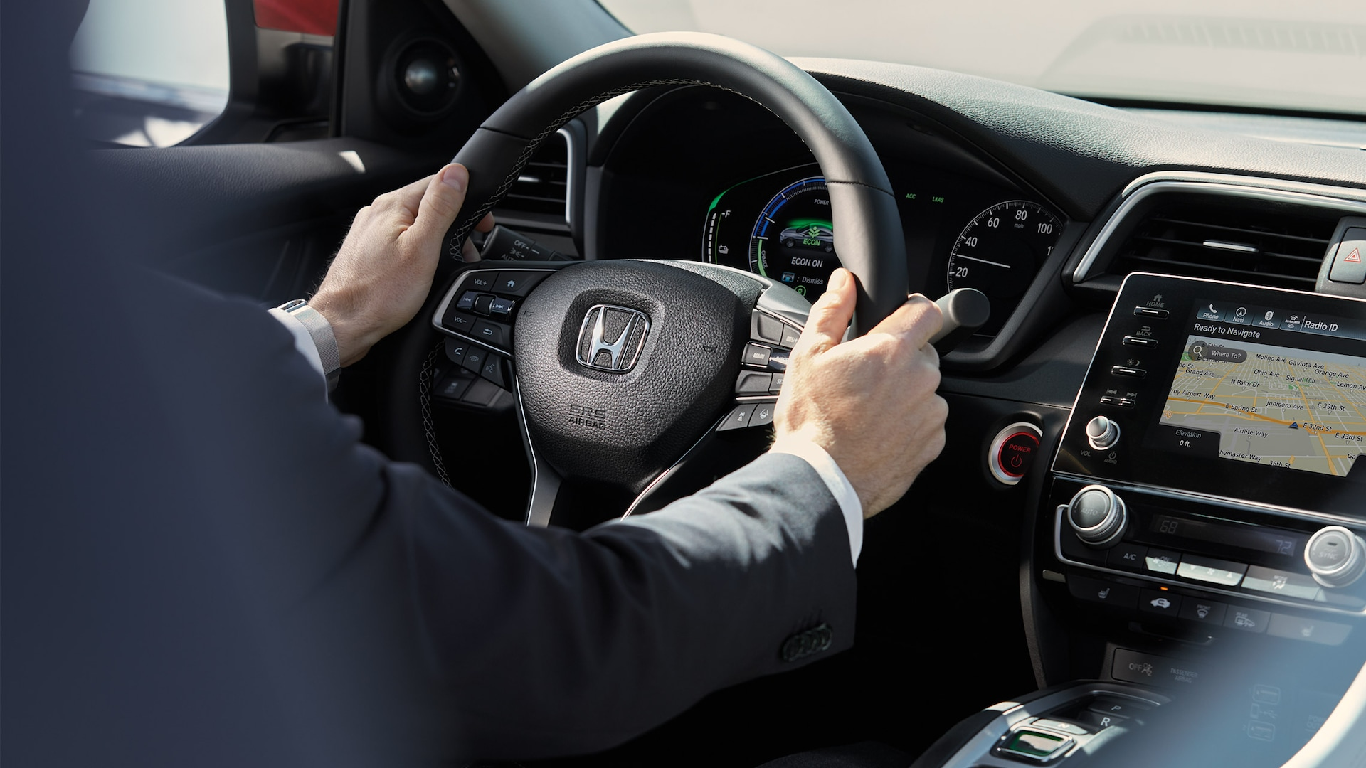 Interior view of instrument panel in 2020 Honda Insight Touring with Beige interior.