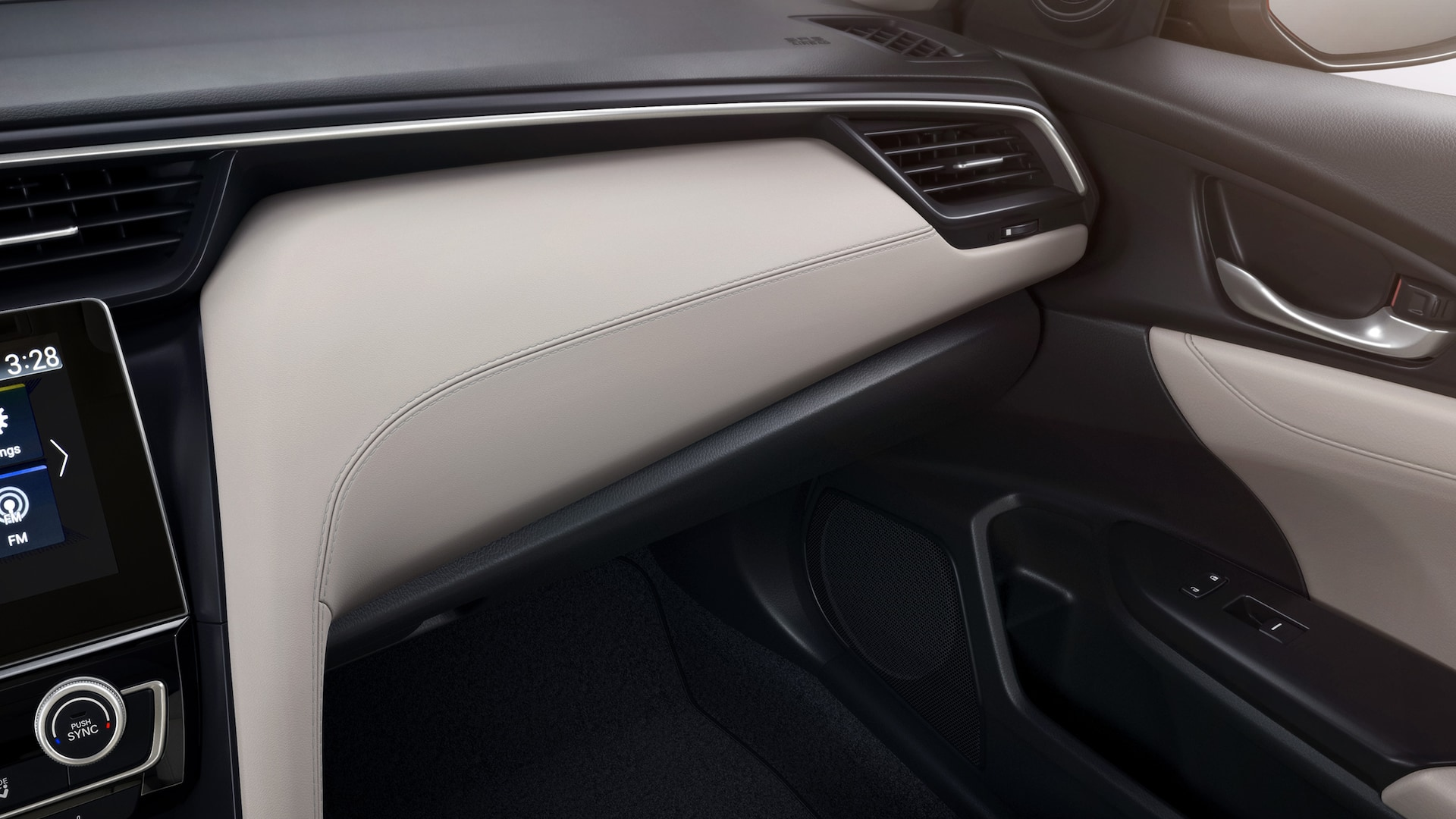 Interior close-up view of dash trim on 2020 Honda Insight Touring with Ivory leather interior.