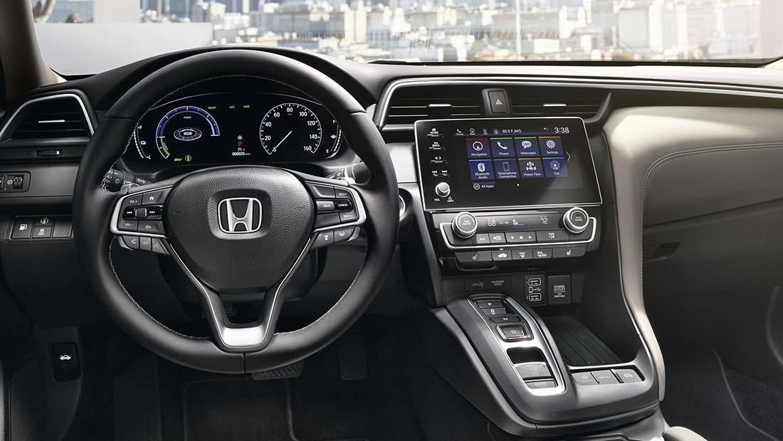 Interior view of steering wheel and dash on 2020 Honda Insight Touring with Ivory Interior.