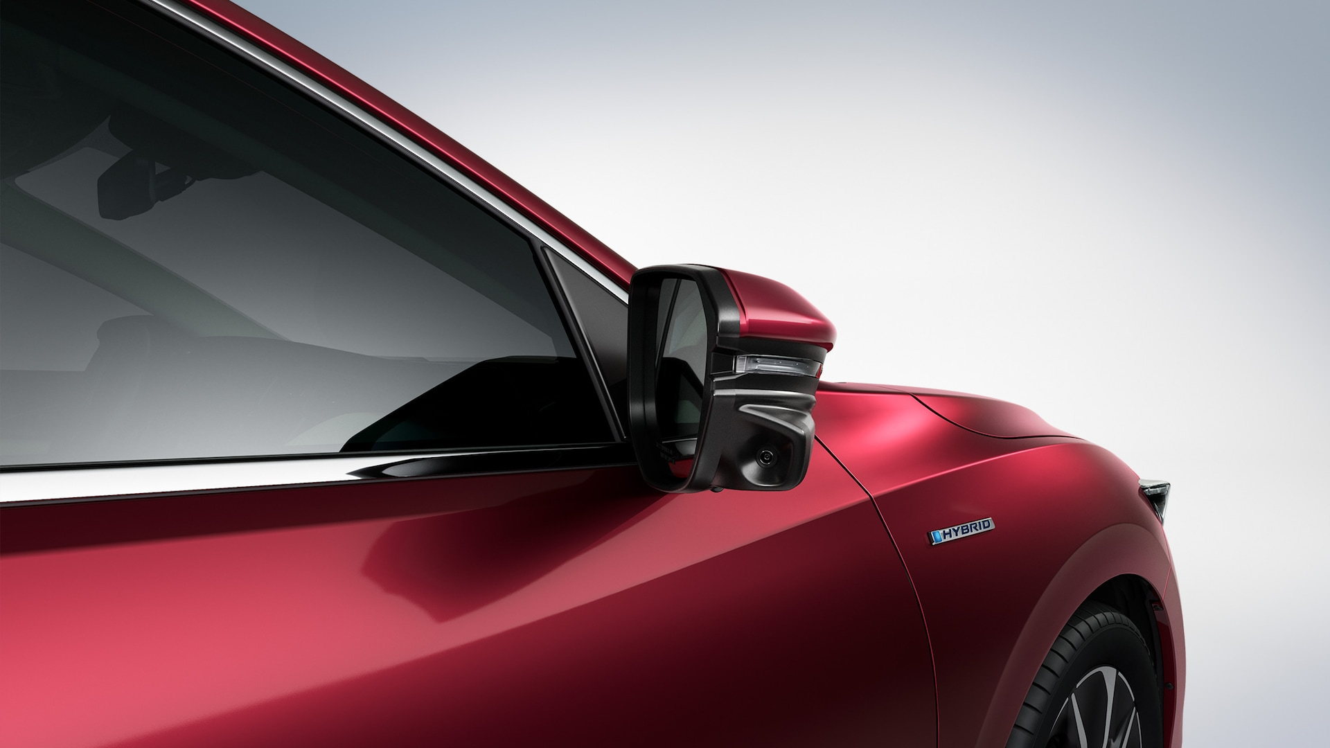 Honda LaneWatch™ camera detail on passenger's side mirror on 2020 Honda Insight in Crimson Pearl.