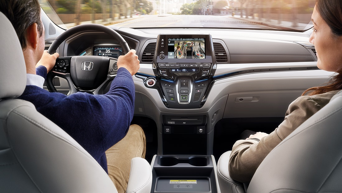 Rear view of steering wheel and dash in 2020 Honda Odyssey Elite with Gray Leather.