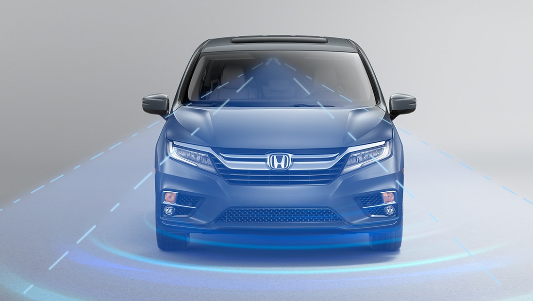 Front view of 2020 Honda Odyssey Elite in Modern Silver Metallic demonstrating Adaptive Cruise Control (ACC).