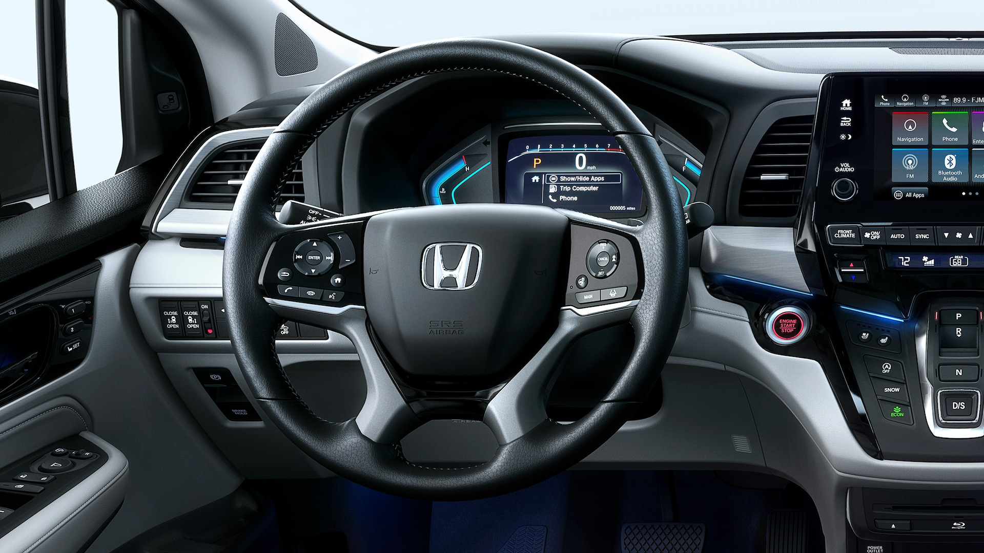 Heated, leather-wrapped steering wheel detail on 2020 Honda Odyssey Elite.