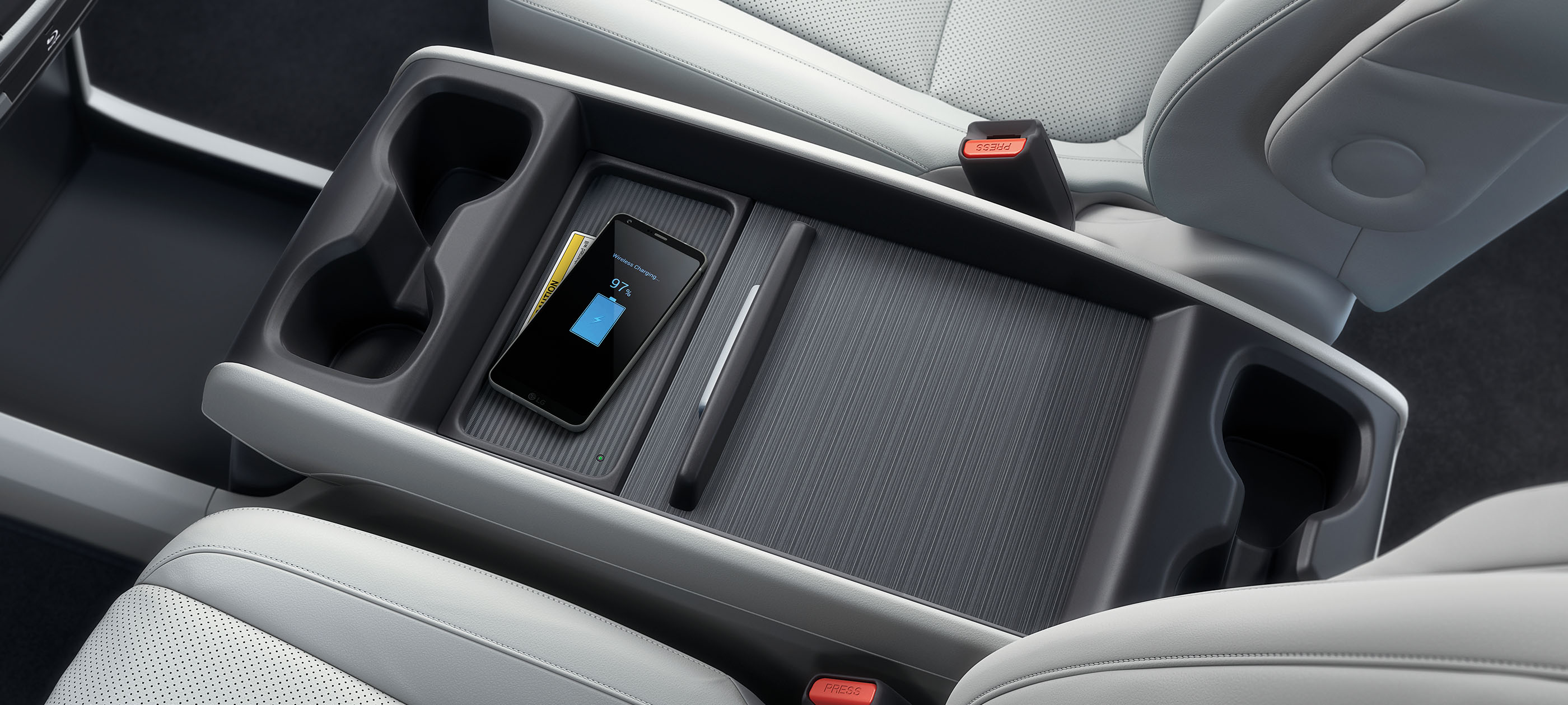 Interior overhead view of wireless phone charger and center console in the 2020 Honda Odyssey Elite with Gray Leather.