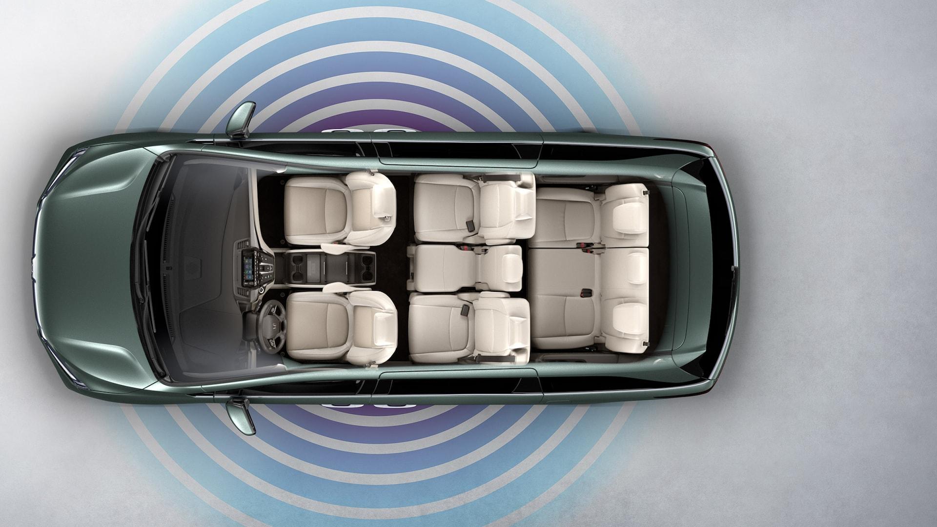 Vista aérea de la Honda Odyssey Elite2020 en Forest Mist Metallic con superposición de gráficos de la zona interactiva móvil.