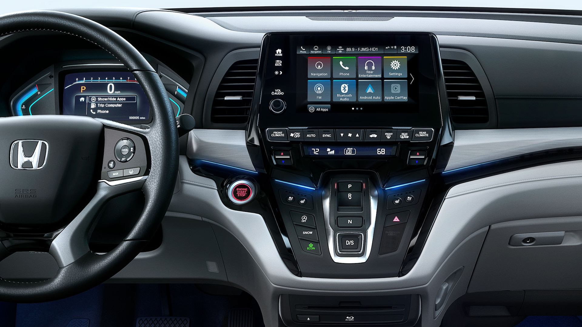 Interior rear close-up view of steering wheel and dash in 2020 Honda Odyssey Elite with Gray Leather