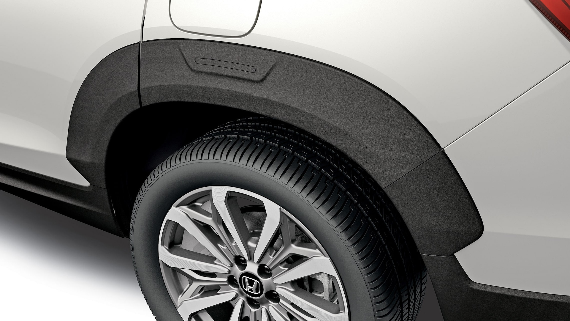 Detail of accessory fender flare on the 2020 Honda Passport.