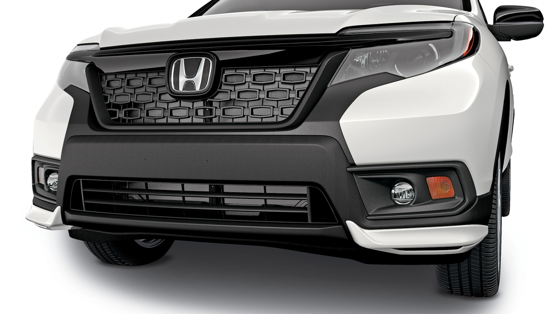 Detail of accessory front underbody spoiler on the 2020 Honda Passport.
