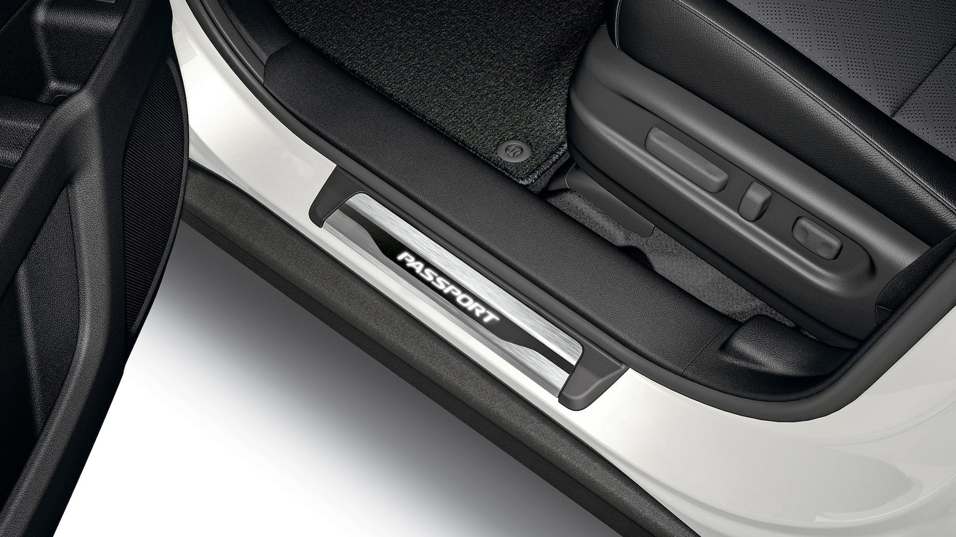 Detail of accessory illuminated door sill trim on the 2020 Honda Passport.