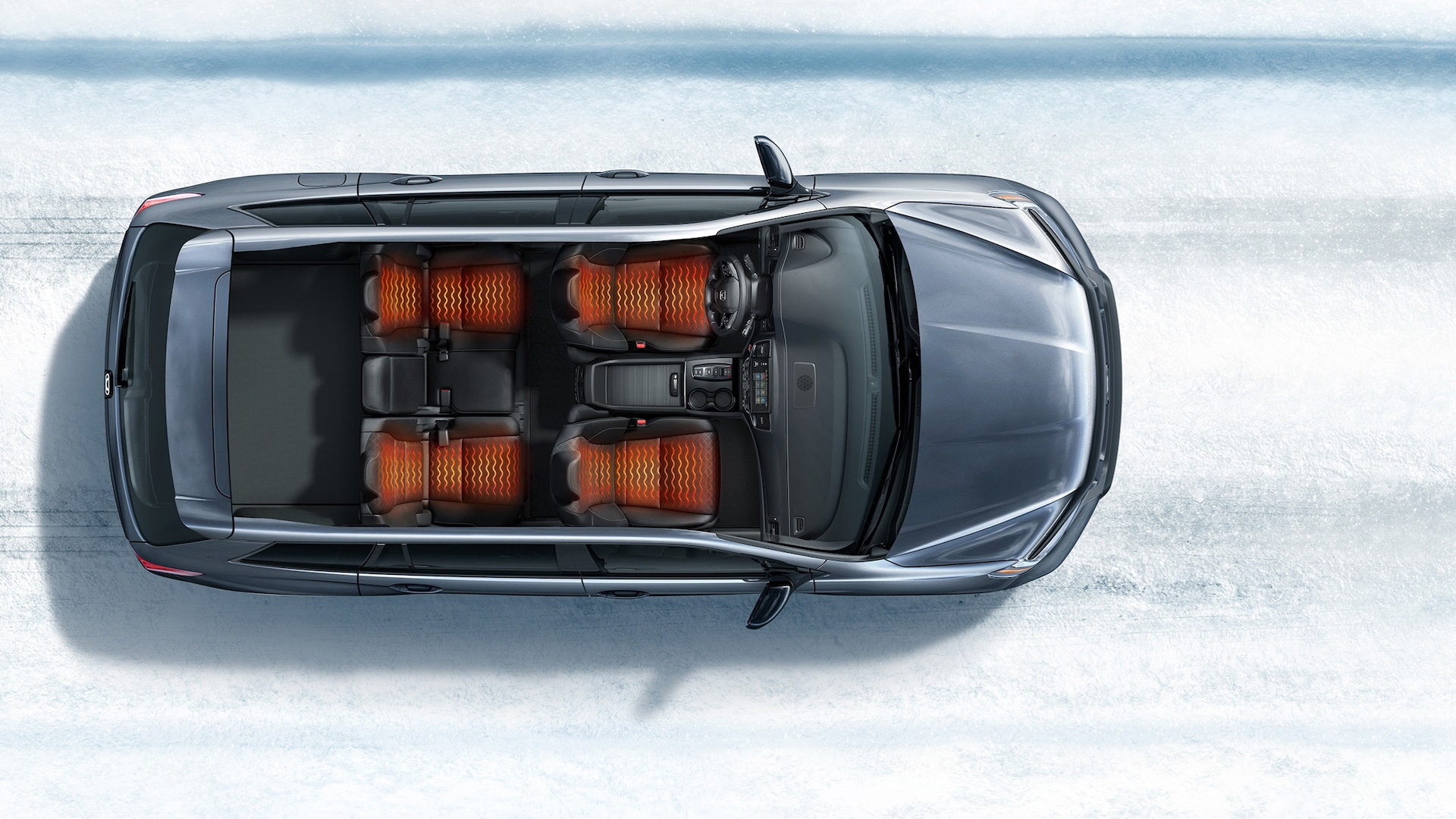 Overhead view of 2020 Honda Passport Elite demonstrating heated seats in a snowy road environment.