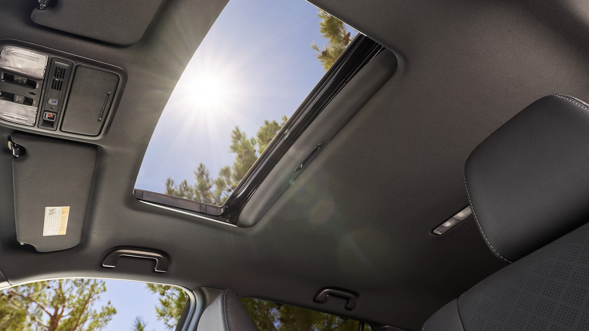Interior view with one-touch power moonroof detail on the 2020 Honda Passport Elite.
