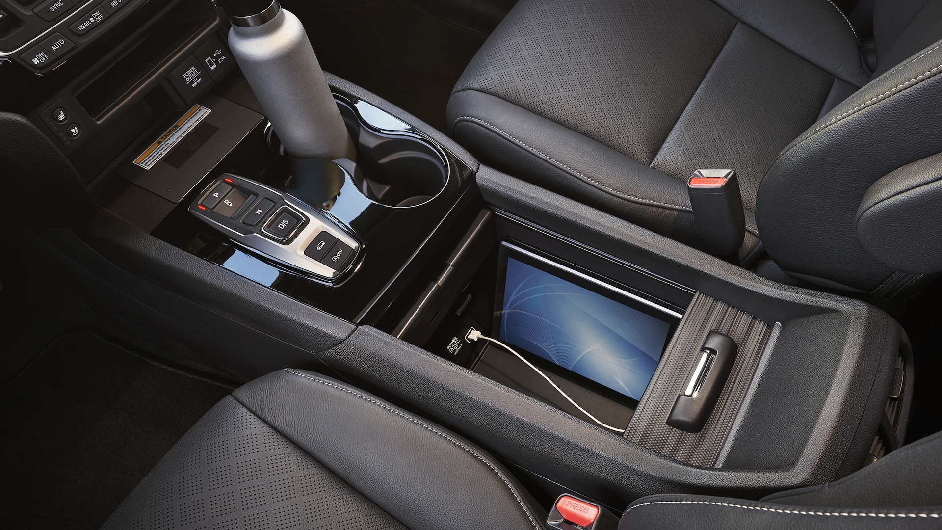 2020 Honda Passport Elite with Black Leather interior displaying multi-functional center console.