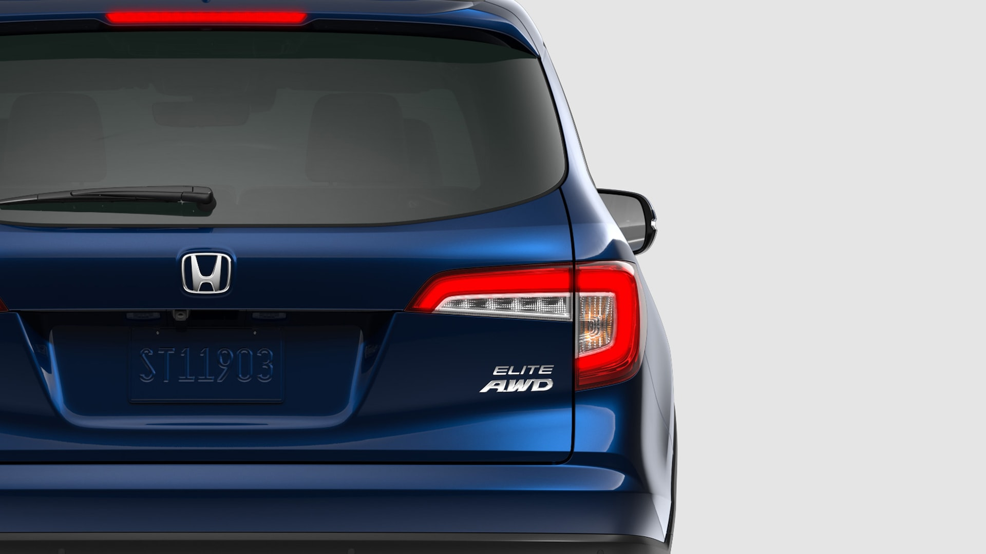 Rear driver's side close-up view of 2020 Honda Pilot Elite in Steel Sapphire Metallic.