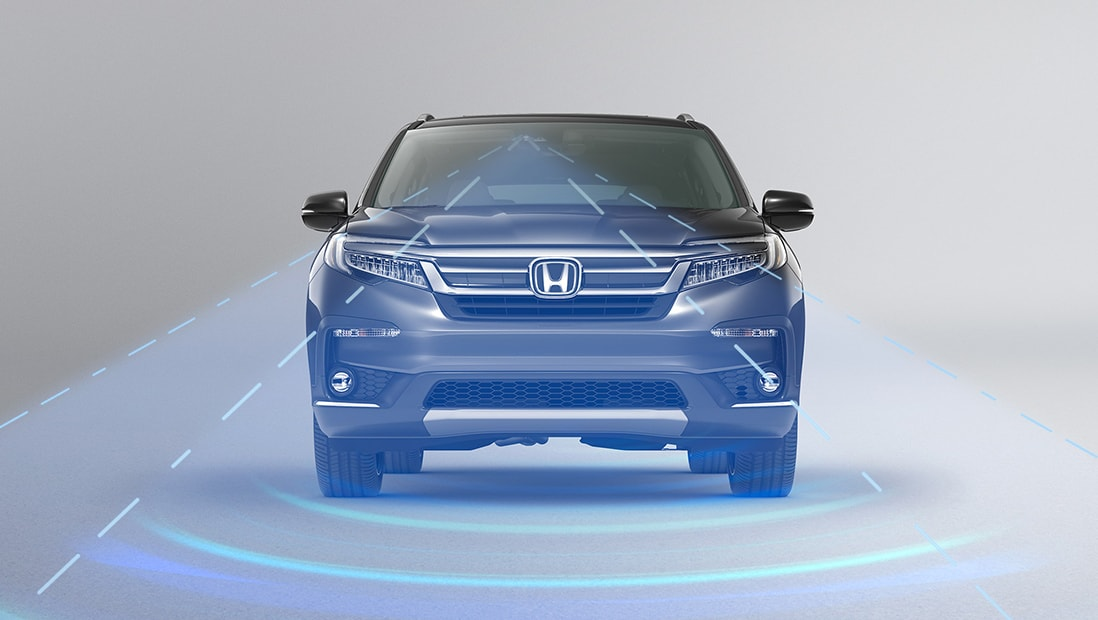 Straight front view of 2020 Honda Pilot Elite displaying Adaptive Cruise Control technology.