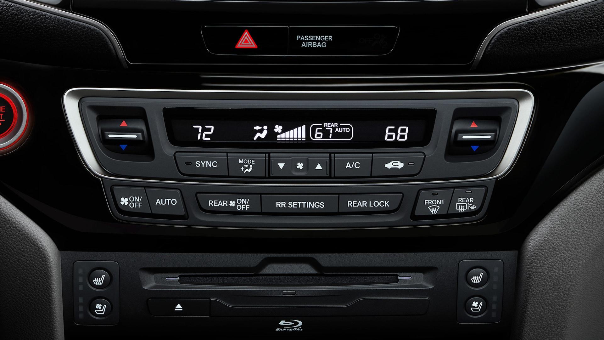 Detalle del panel de control de clima en la Honda Pilot Elite2020.