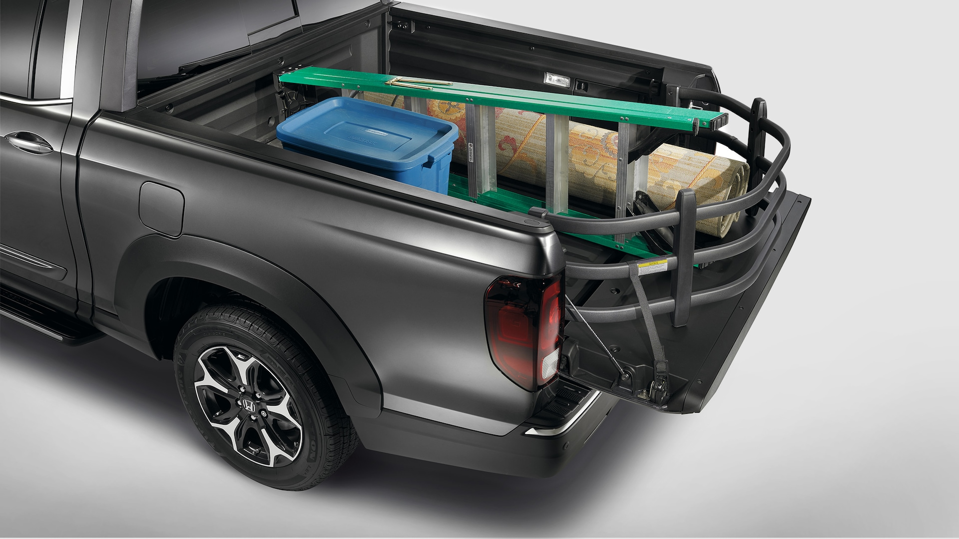 Truck-bed extender detail on the 2020 Honda Ridgeline RTL-E in Modern Steel Metallic.