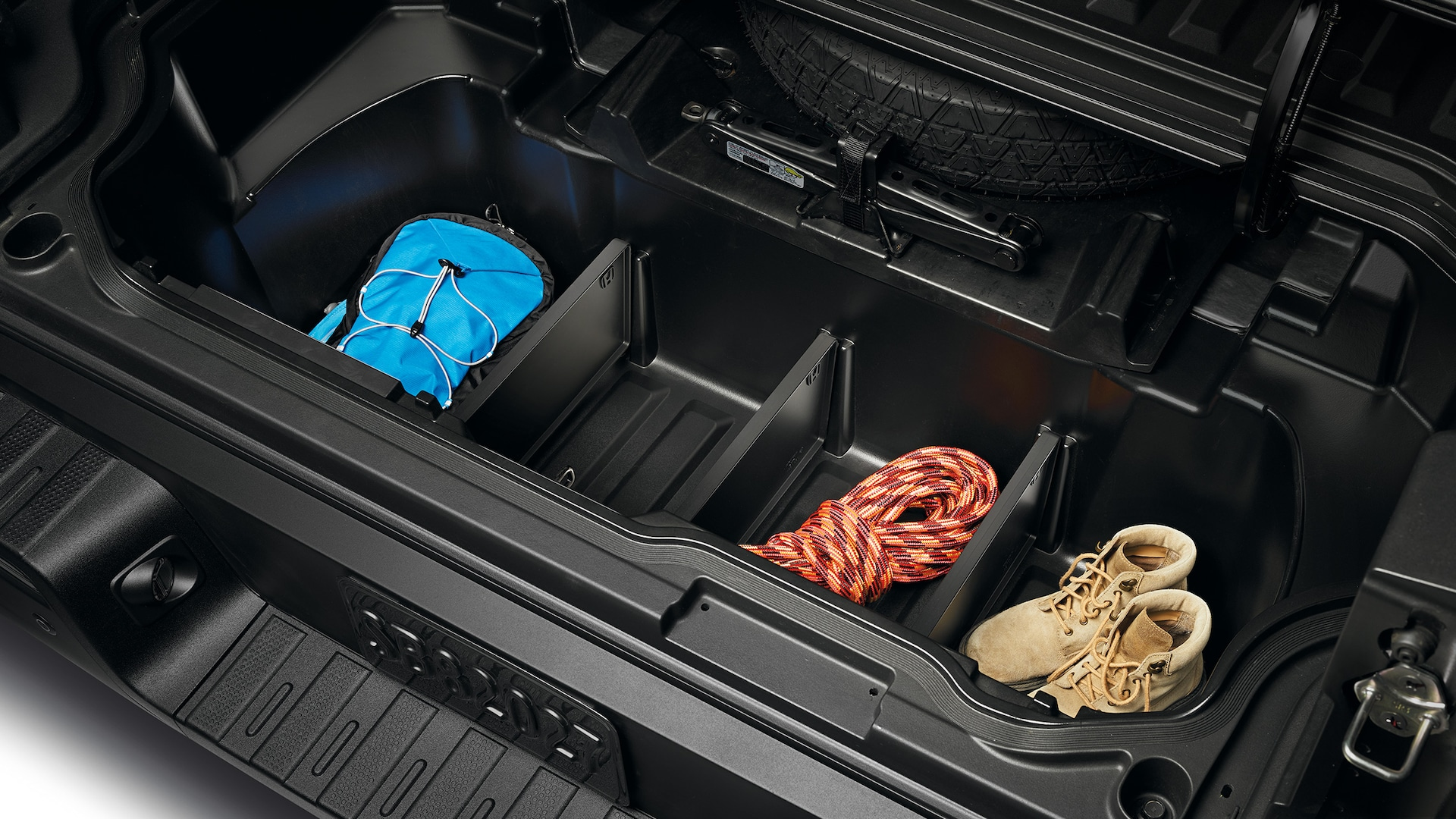 Truck-bed cargo dividers in the 2020 Honda Ridgeline RTL-E in Modern Steel Metallic.