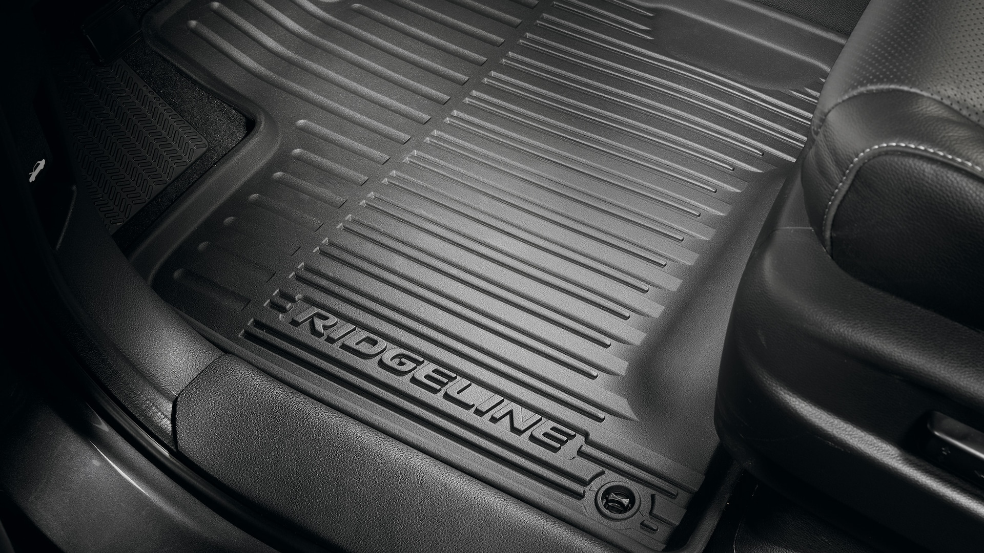 All-season floor-mat detail in the 2020 Honda Ridgeline RTL-E in Modern Steel Metallic.