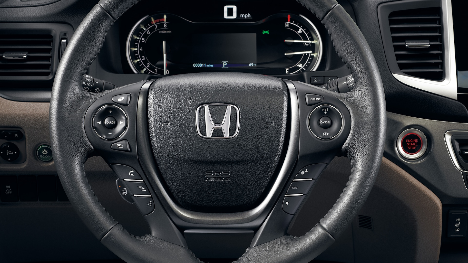 Steering-wheel detail in the 2020 Honda Ridgeline RTL-E with Beige Leather.