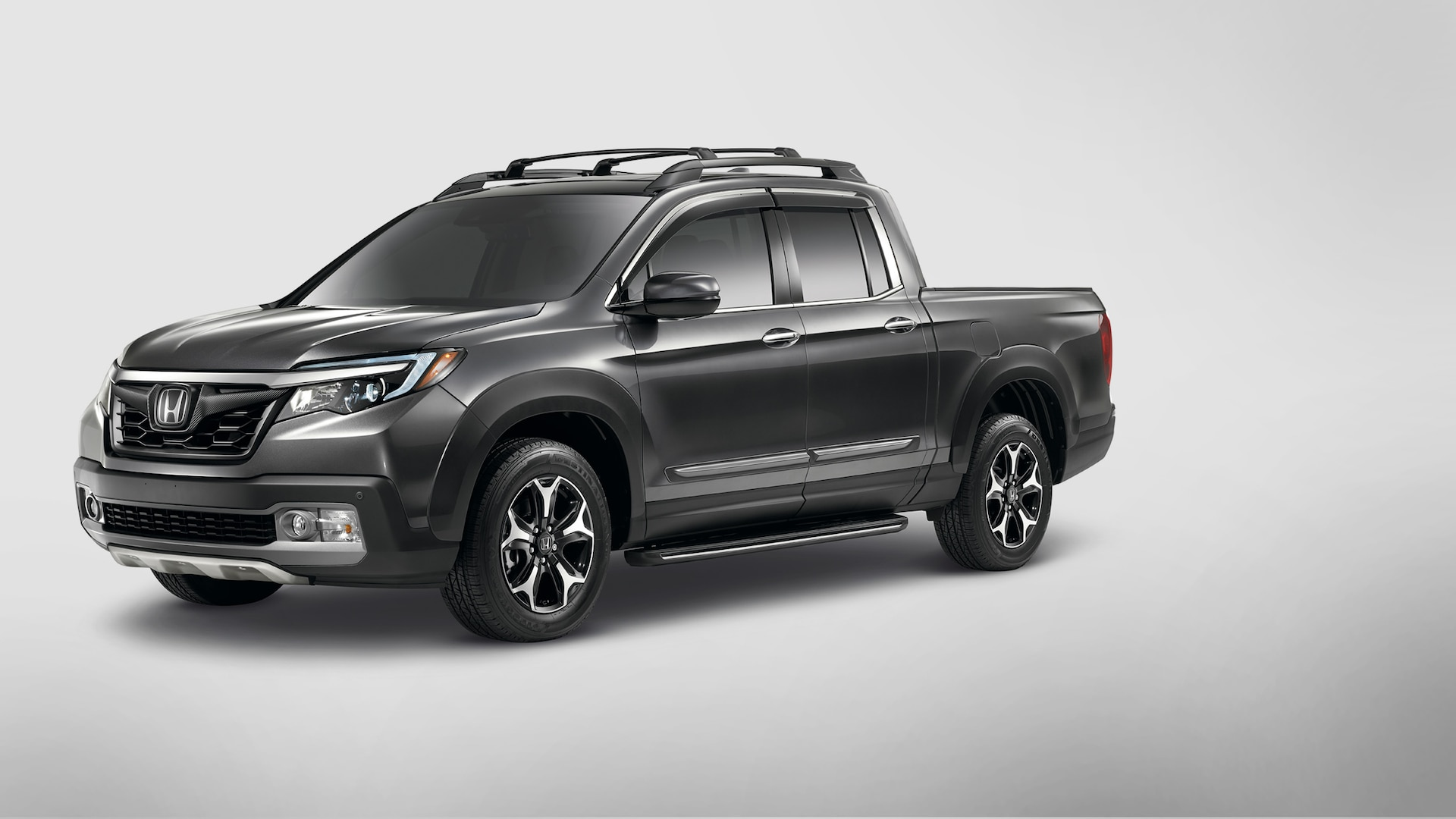Roof rails with crossbars detail on the 2020 Honda Ridgeline RTL-E in Modern Steel Metallic.