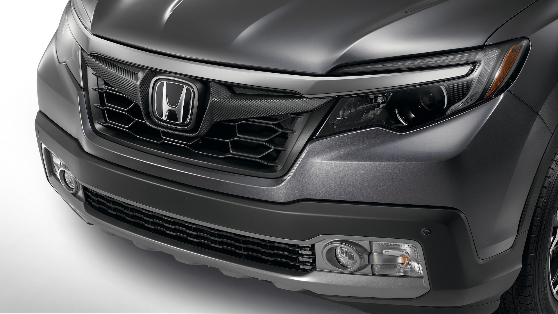 Sport grille detail on the 2020 Honda Ridgeline RTL-E in Modern Steel Metallic.