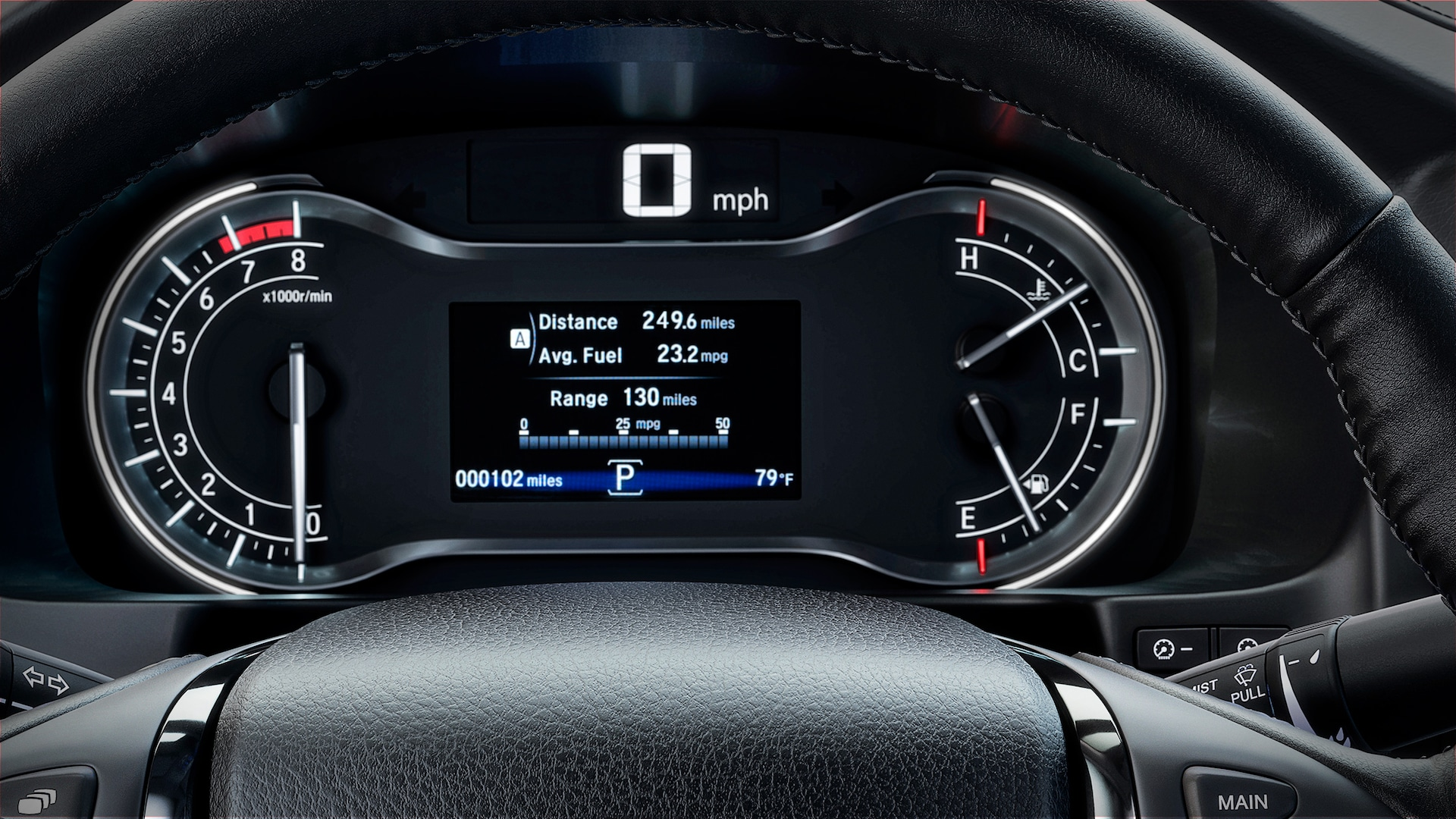 Driver information interface and steering wheel detail in the 2020 Honda Ridgeline RTL-E with Gray Leather.