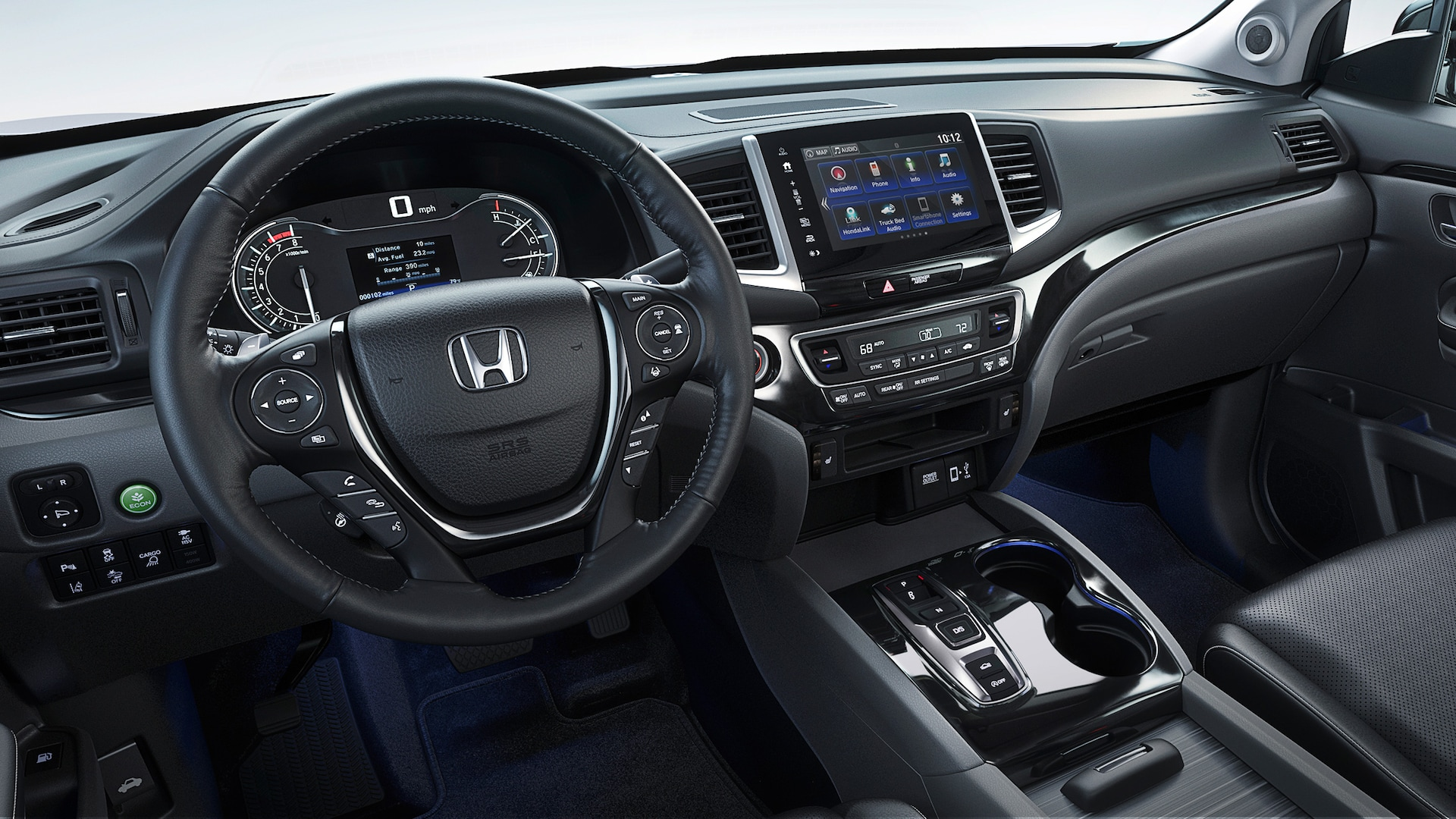 Interior driver's point of view of the steering wheel and instrument panel in the 2020 Honda Ridgeline RTL-E with Black Leather.