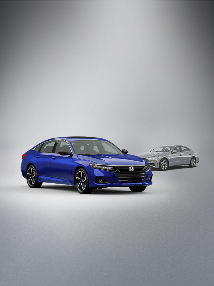 Front passenger-side view of the 2021 Honda Accord Sport SE in Still Night Pearl parked in front of the 2020 Hyundai Sonata SEL.