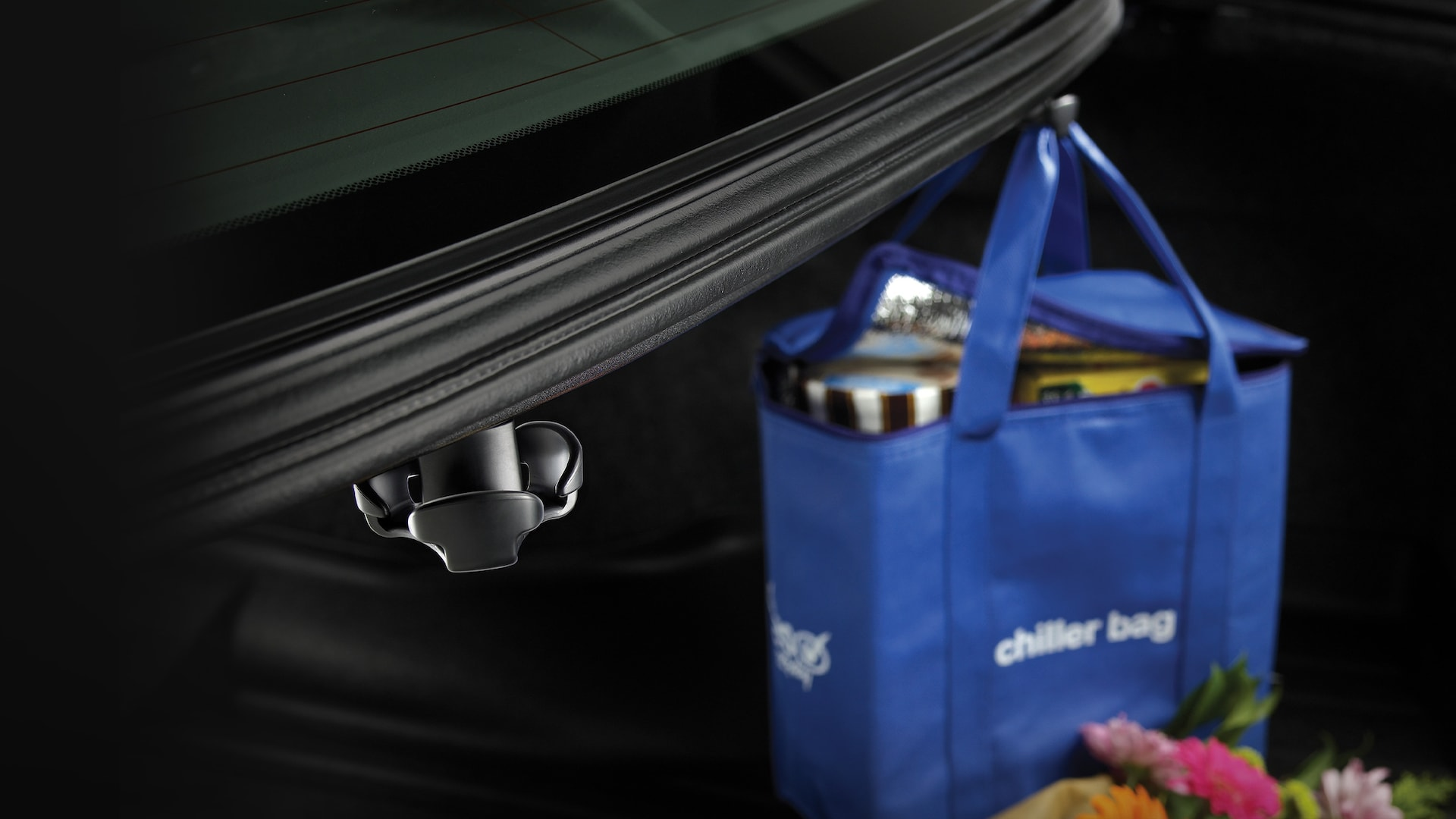 Detail of accessory cargo hook holding groceries in the 2021 Honda Accord.