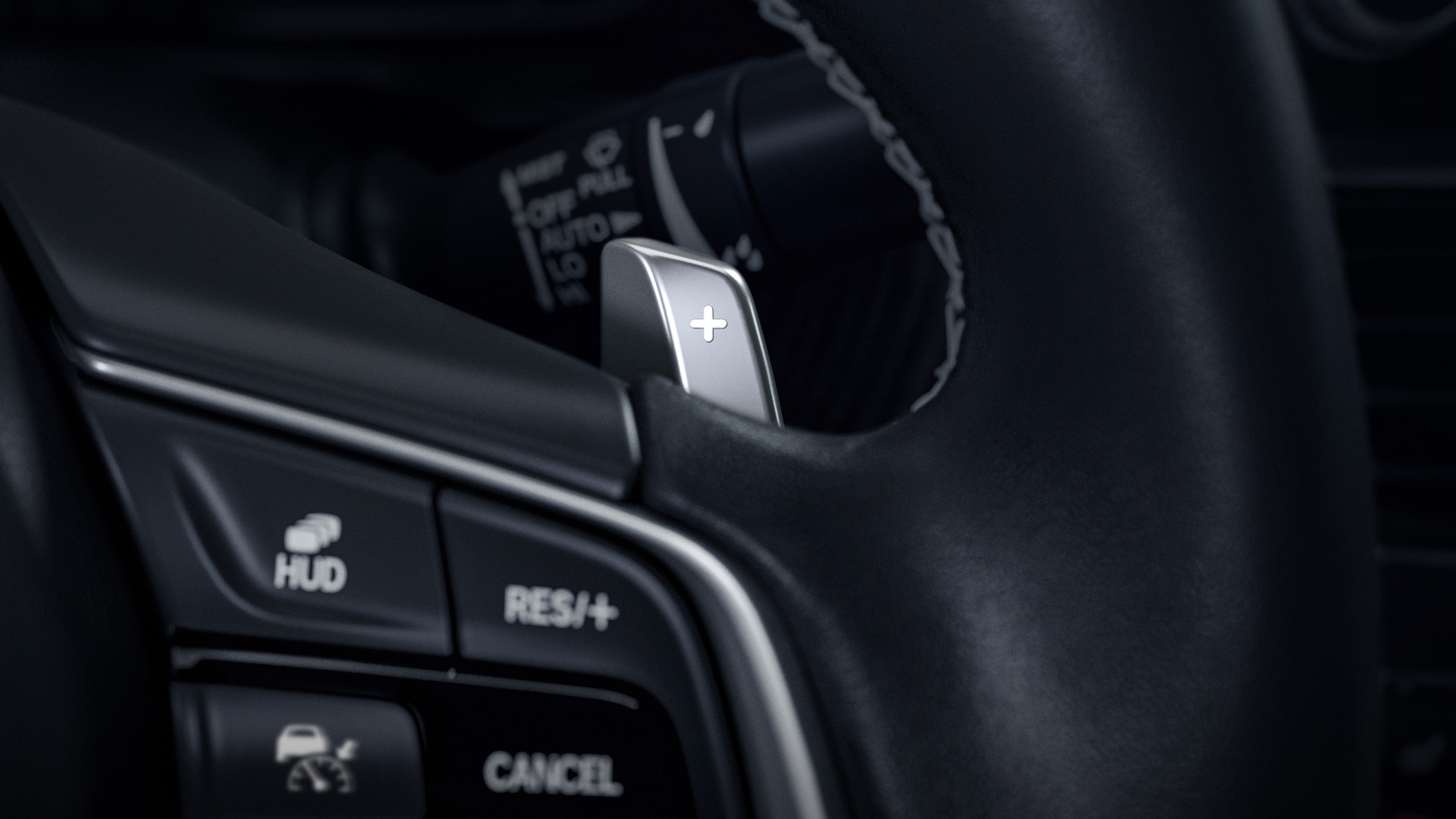 Steering wheel-mounted paddle shifter detail in the 2021 Honda Accord Touring 2.0T.