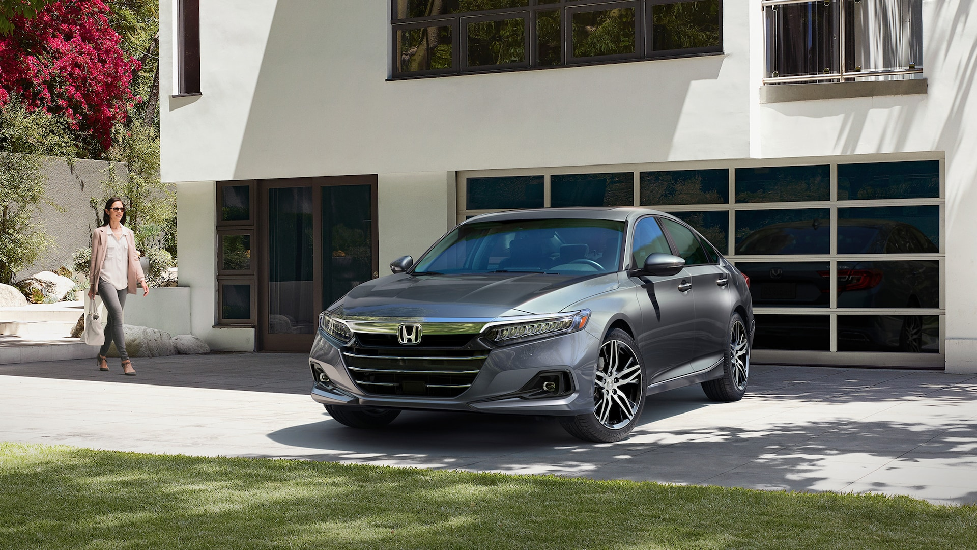 2021 Honda Accord Touring 2.0T in Modern Steel Metallic, parked in front of modern home.