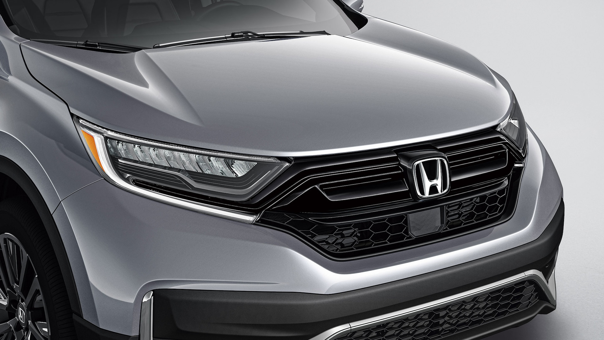 Detail of accessory gloss-black grille on the 2021 Honda CR-V.