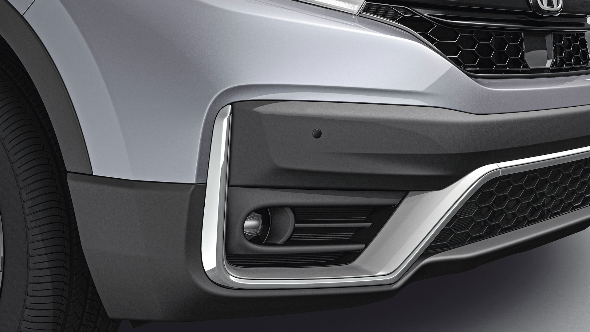 Rear passenger-side close-up view of accessory parking sensors on the 2021 Honda CR-V in Sonic Gray Pearl.
