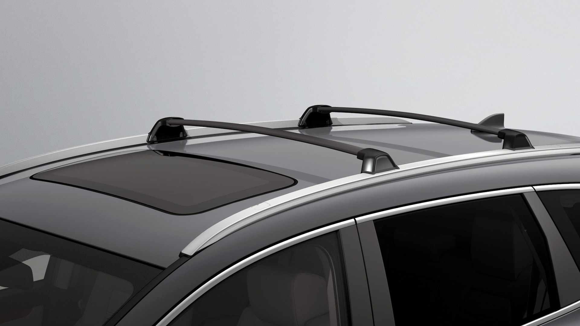 Accessory roof rails and crossbars detail on the 2021 Honda CR-V in Sonic Gray Pearl.