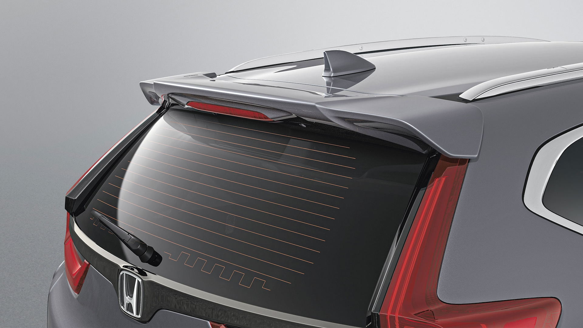 Detail of accessory tailgate spoiler on the 2021 Honda CR-V.