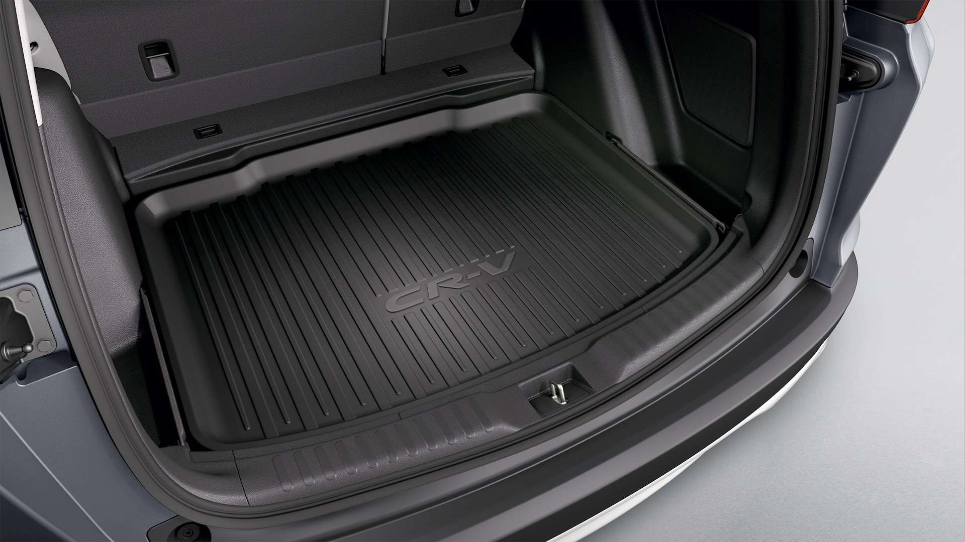 Interior view of accessory cargo tray in the 2021 Honda CR-V Touring with Gray Leather.