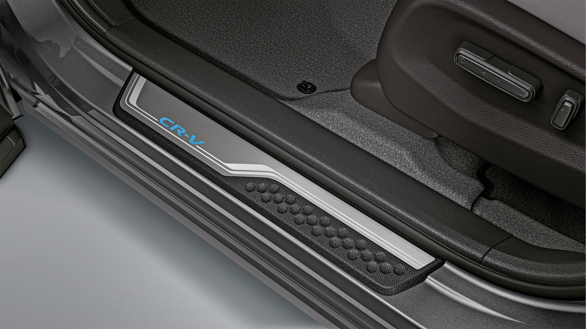 Detail view of accessory illuminated door sill trim in the 2021 Honda CR-V Touring with Gray Leather.