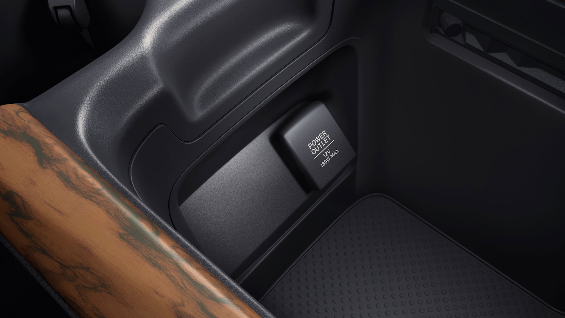 Detail view of 12-volt power outlet in the 2021 Honda CR-V with Black Leather.
