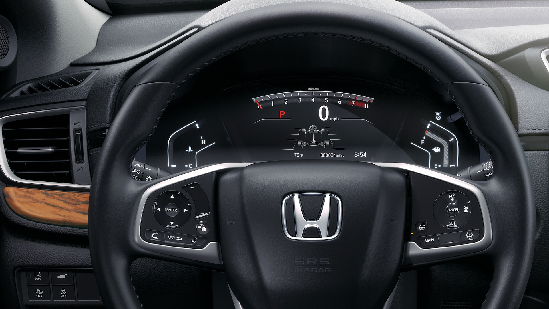 Detail view of the steering wheel and dash in the 2021 Honda CR-V with Gray Leather.