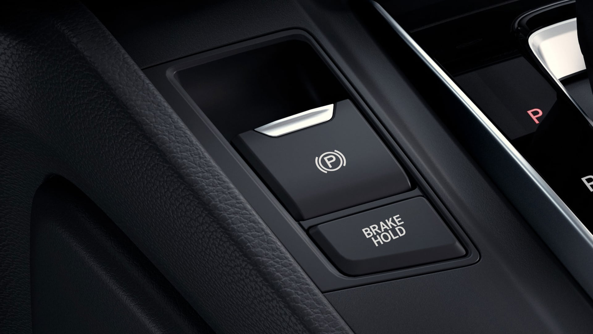 Detail view of the electric parking brake in the 2021 Honda CR-V.