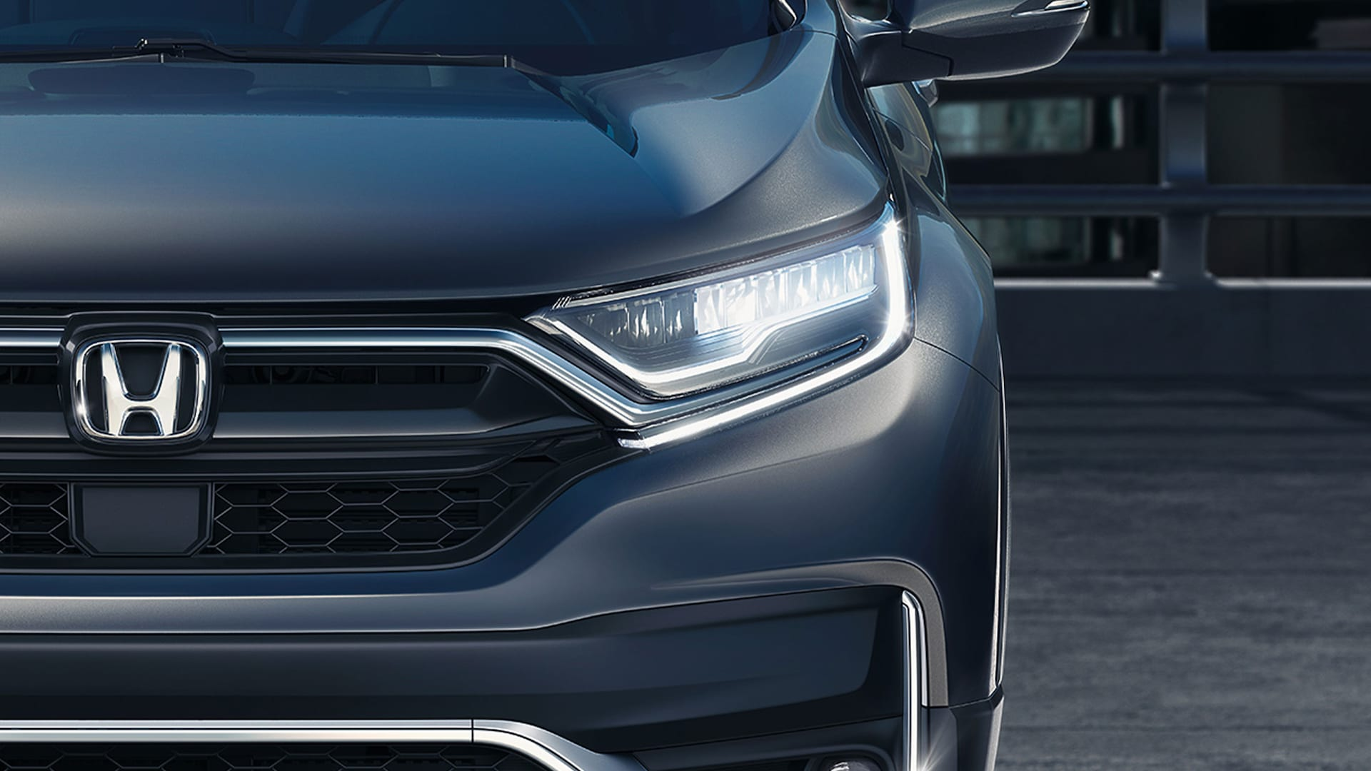 Front close-up view of LED headlights on the 2021 Honda CR-V Touring in Modern Steel Metallic.