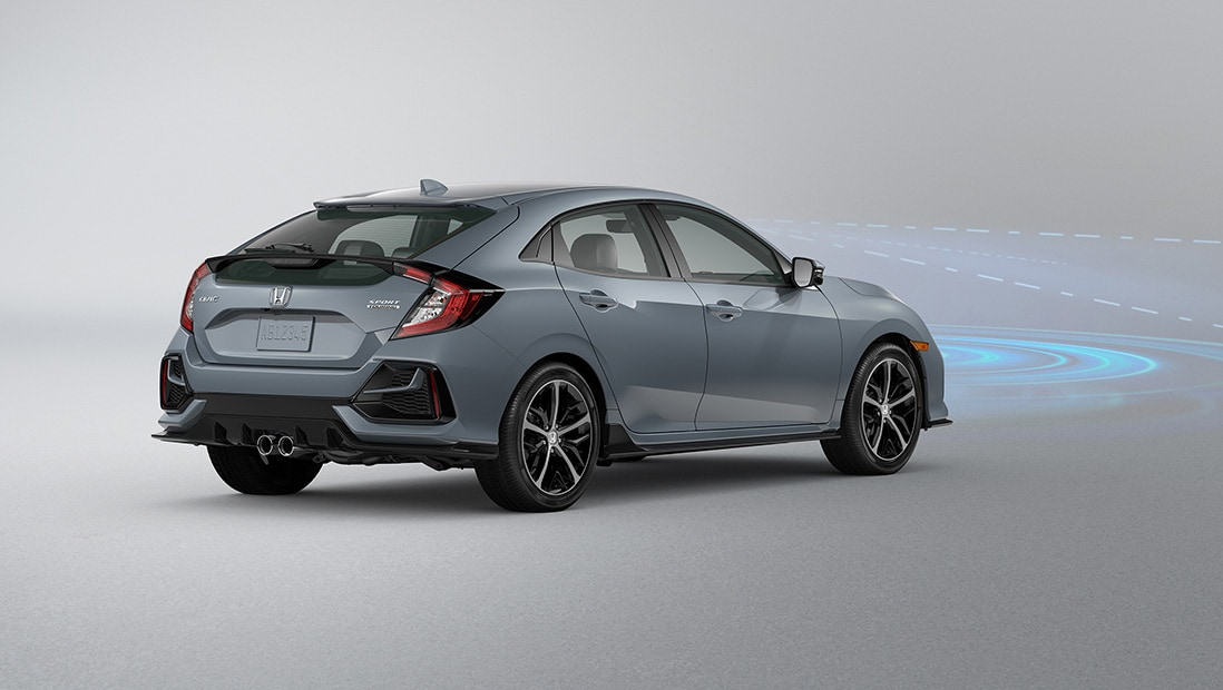 Rear passenger-side view of the 2021 Honda Civic Sport Touring Hatchback in Sonic Gray Pearl, demonstrating Collision Mitigation Braking System.