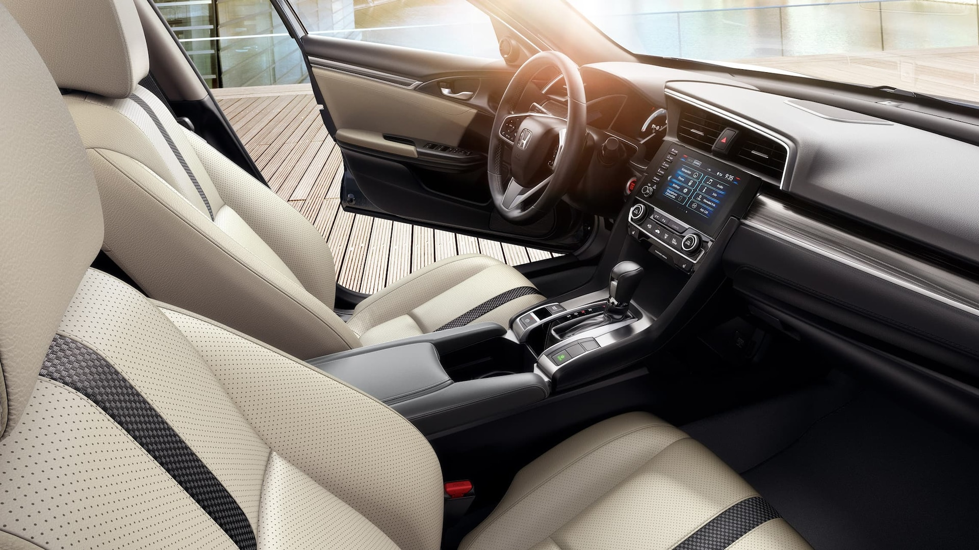 Interior passenger-side view of front seats in the 2021 Honda Civic Touring Sedan in Ivory Leather.