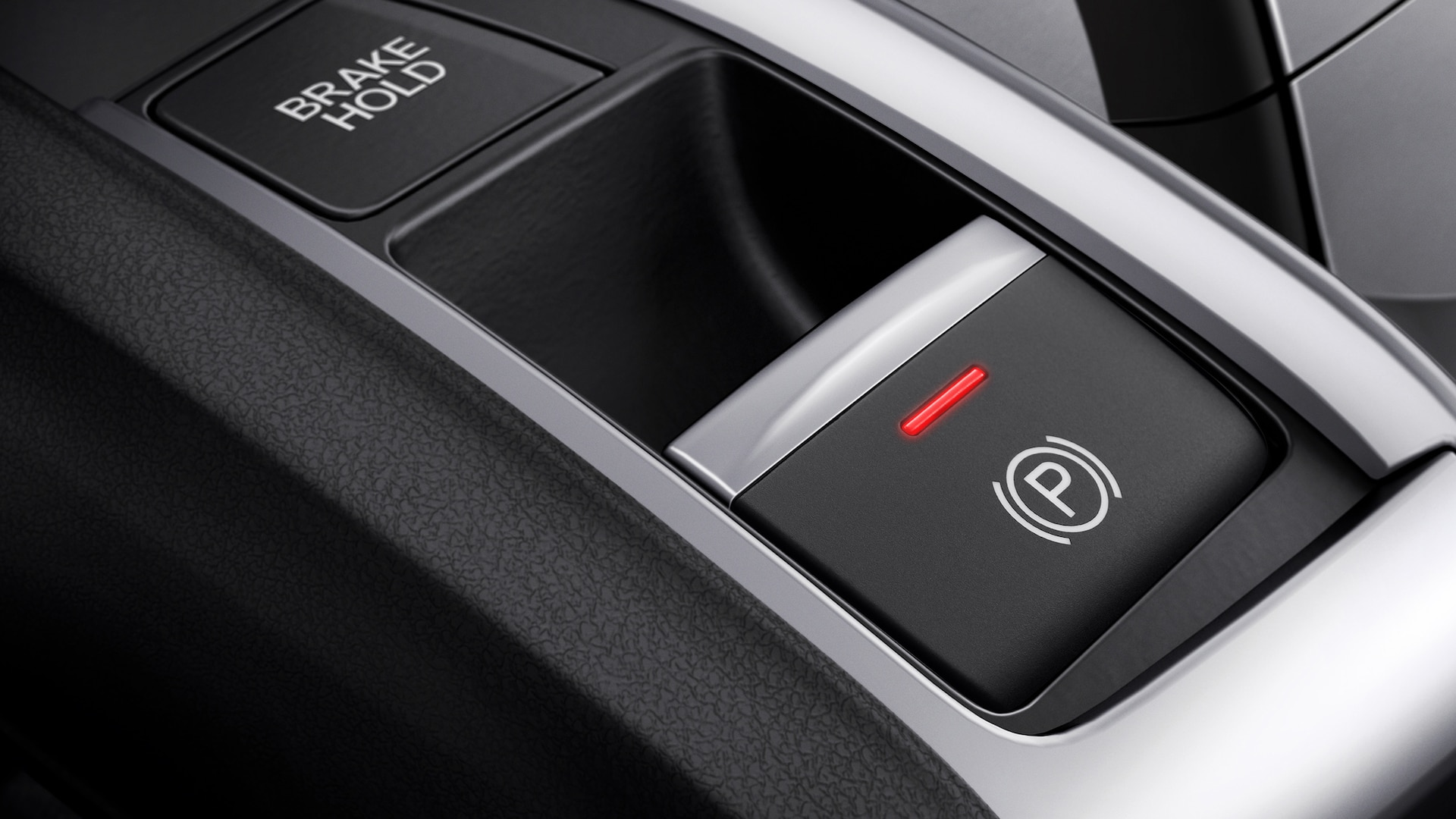 Electric parking brake button detail in the 2021 Honda Civic Sedan.