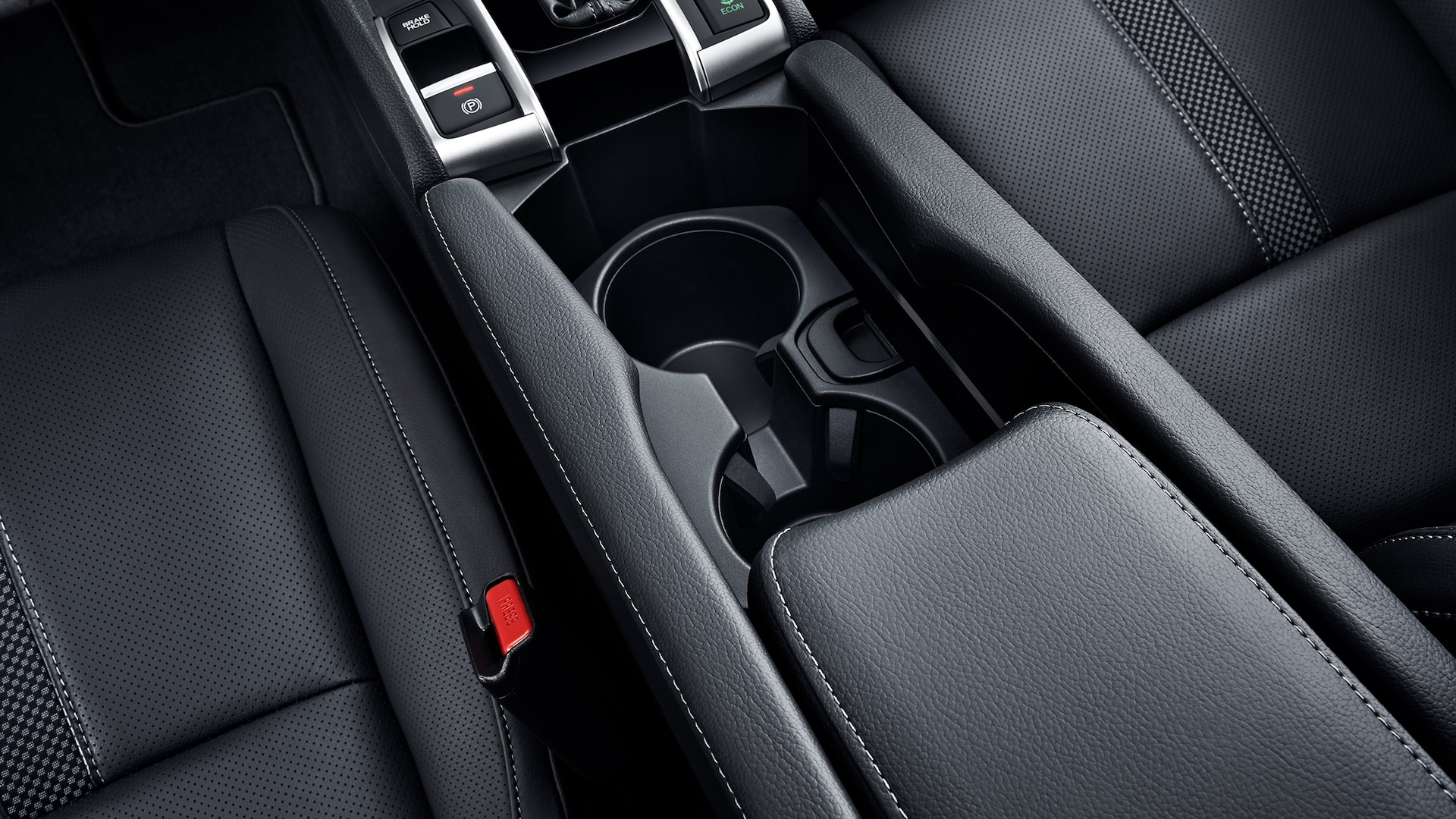 Detail of center console and beverage holders in the 2021 Honda Civic Touring Sedan shown with Black Leather.