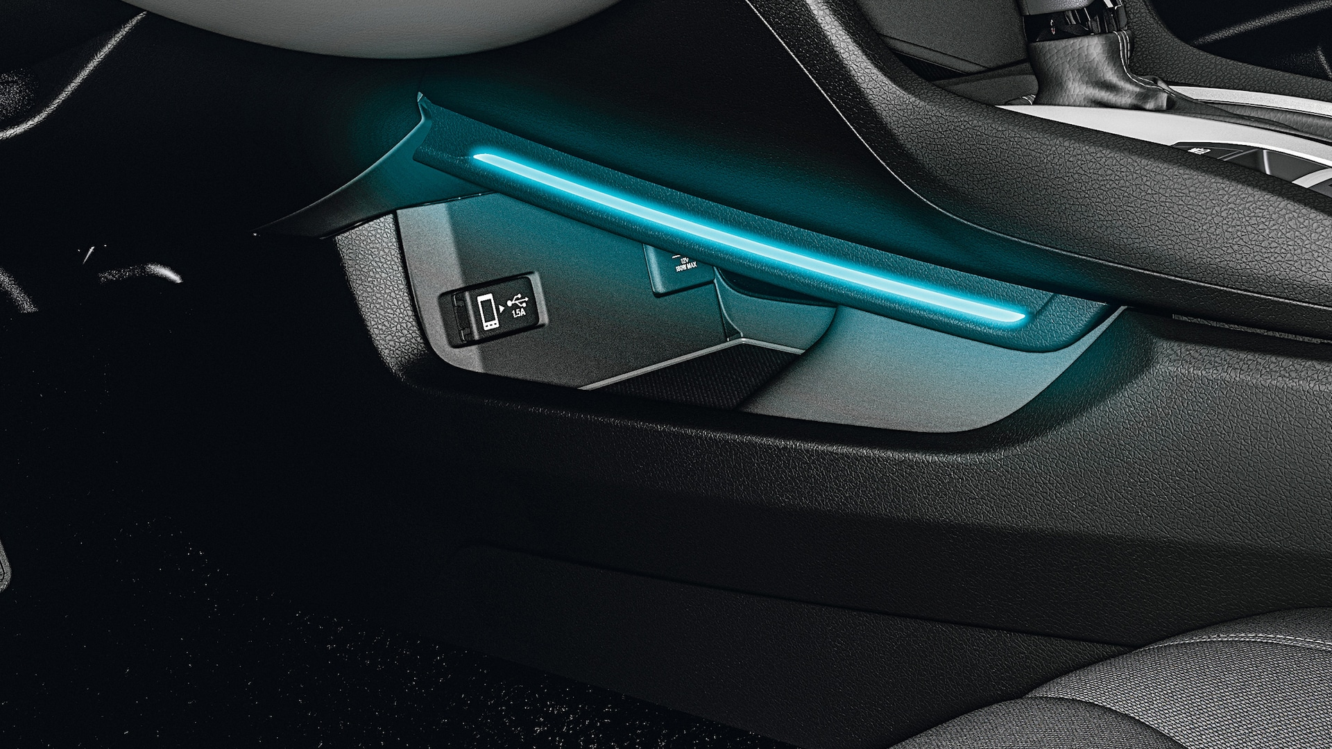Illuminated driver-side console detail in the 2021 Honda Civic Sedan.