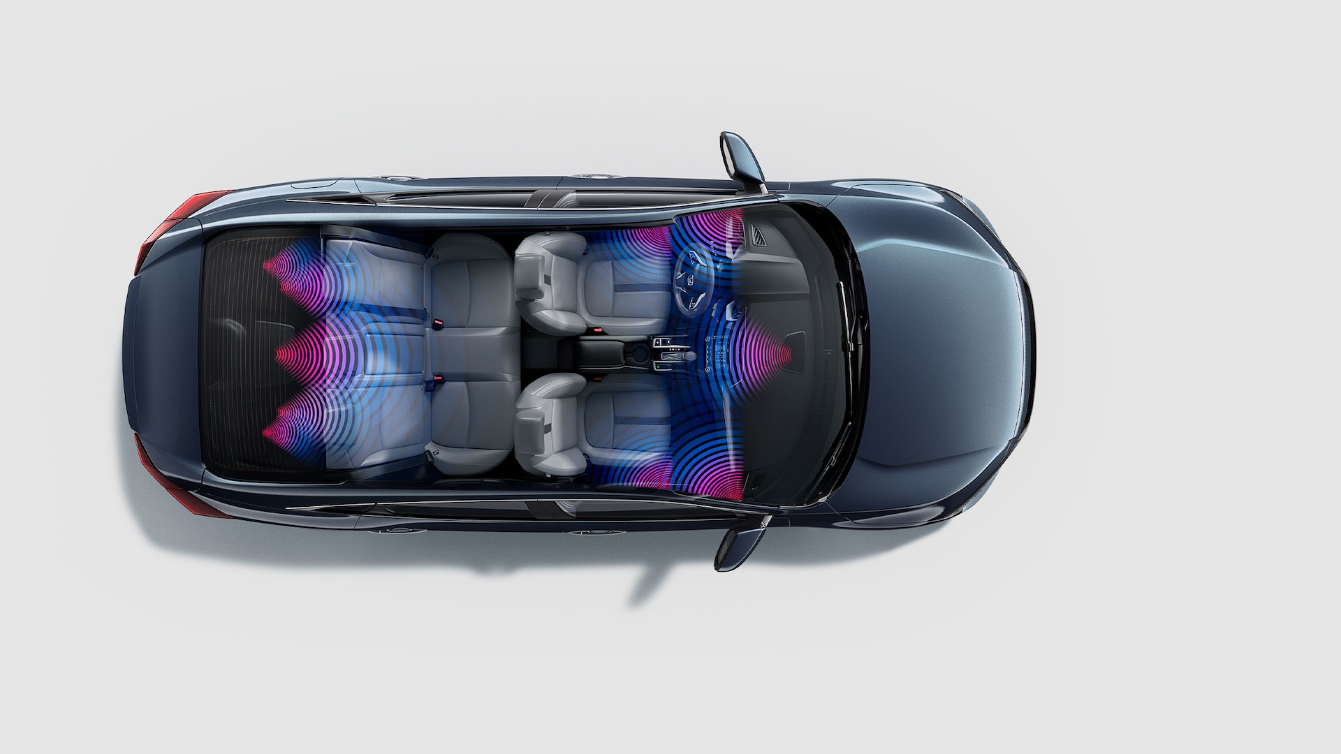 Overhead view of the 2021 Honda Civic Touring Sedan in Cosmic Blue Metallic with illustrated audio sound waves.
