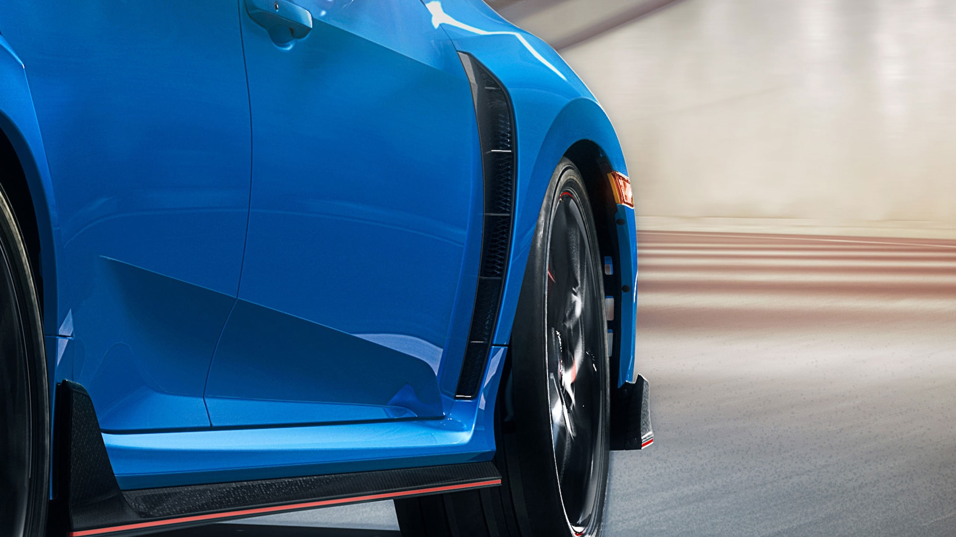 Detail of wide front fender vents on 2021 Honda Civic Type R in Boost Blue Pearl.
